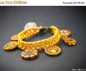 charm bracelet, yellow and white, and yellow bracelet image
