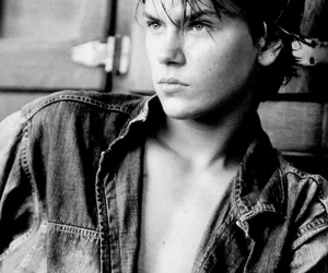 river phoenix and black and white image
