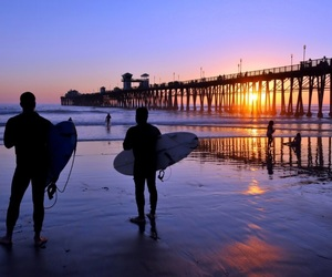 surfing and oceanside pier image