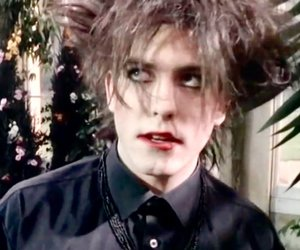robert smith, the cure, and 80s image