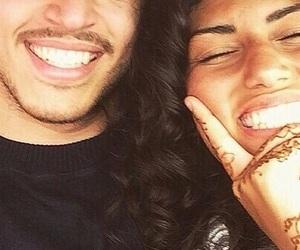 couple, smile, and henna image