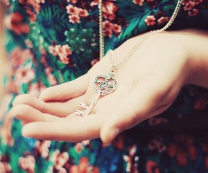 key, necklace, and flowers image