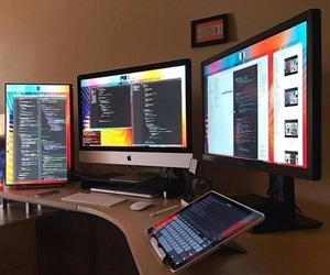 hacker, monitors, and tablet image