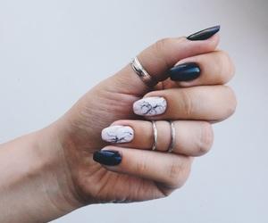 marble, nail, and ring image