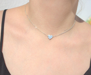 Charlize Theron, charm necklaces, and love necklace image