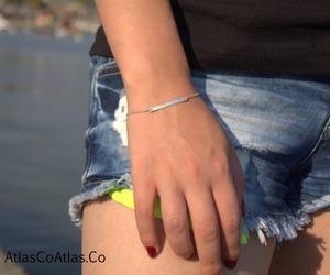 gold bar, sterling silver bar, and name bracelet image