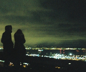 couple, night, and city image