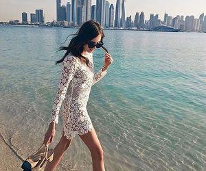 dress and sunglasses image