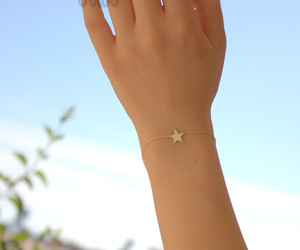 charm bracelet, star necklace, and moon and star image