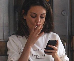 Mila Kunis, cigarette, and smoke image