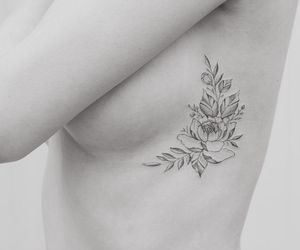 flowers, sideboob, and tatoos image