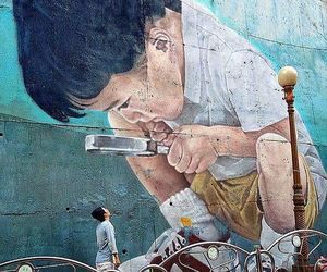 boy, streetart, and magnifying glass image