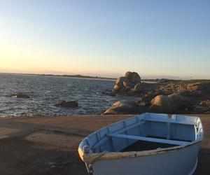 rocks, sea, and sunset image