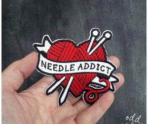 heart, yarn, and needle image