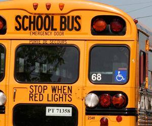 boy, girl, and bus image