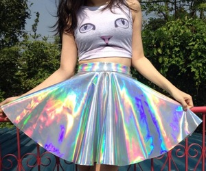 cat, skirt, and holographic image