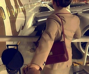 airplane, emirates, and flight attendant image