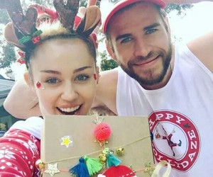 miley cyrus, liam hemsworth, and christmas image