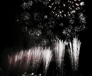 dark, theme, and fireworks image