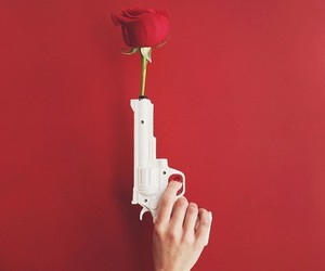 red, rose, and gun image