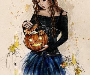 girl and pumpkin image