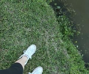 converse, grass, and lake image