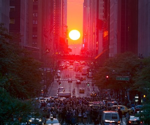city, sunset, and sun image