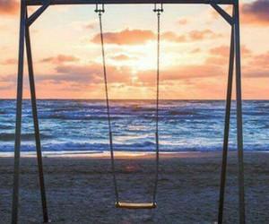sea, sun, and swing image