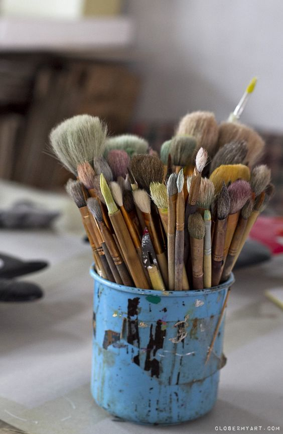 Brushes, paint, and photography image