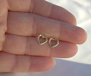 gold stud earrings and open heart earring image