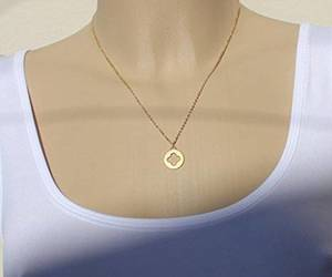 lucky necklace, clover necklace, and gold clover image