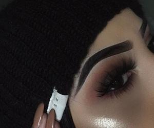 false lashes, makeup, and smokey eye image