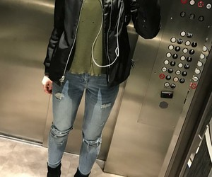 black bomber jacket, blue ripped jeans, and black ankle booties image