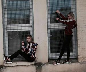 twins, lisa and lena, and girl image