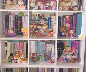book, funko pop, and bookcase image