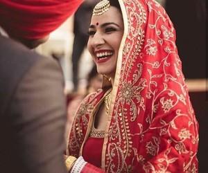 bride, groom, and lehnga image