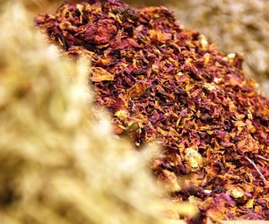 dried leaves, spices, and flowers image