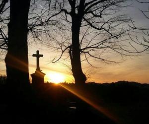 crucifix and sunset image