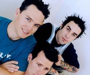 mark hoppus, tom delonge, and travis barker image