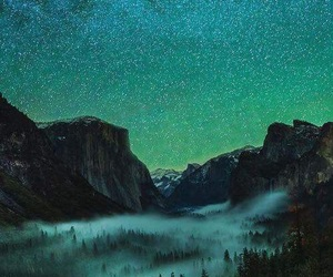 mountains, stars, and forest image
