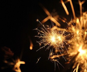 light, fireworks, and gold image
