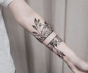 arm tattoo, black ink, and rose image
