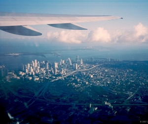 city, plane, and Flying image