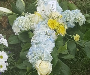 cross, flowers, and funeral image