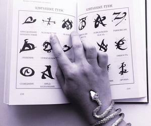 book, bracelet, and movie image