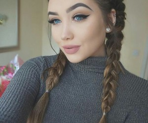 blue eyes, earrings, and hairstyle image