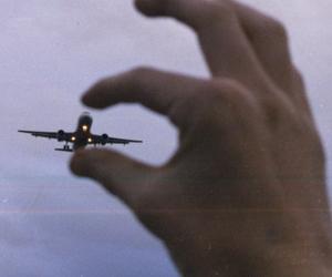 plane, sky, and hand image