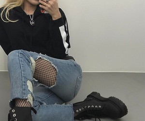 wavy blonde hair, red matte lipstick, and black fishnet tights image