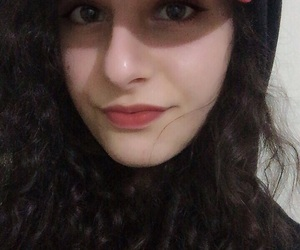 black, cap, and curly hair image