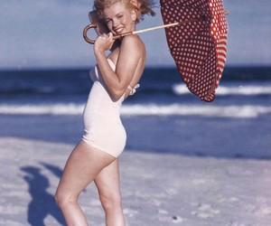 Marilyn Monroe, beach, and umbrella image